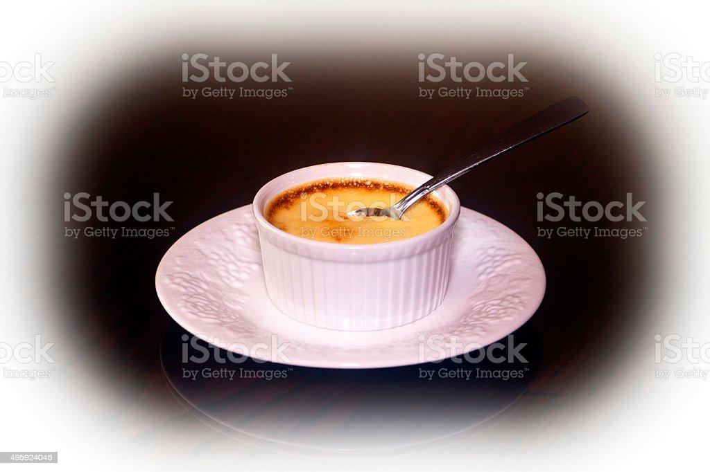 Creme Caramel-Spoon-Plate stock photo