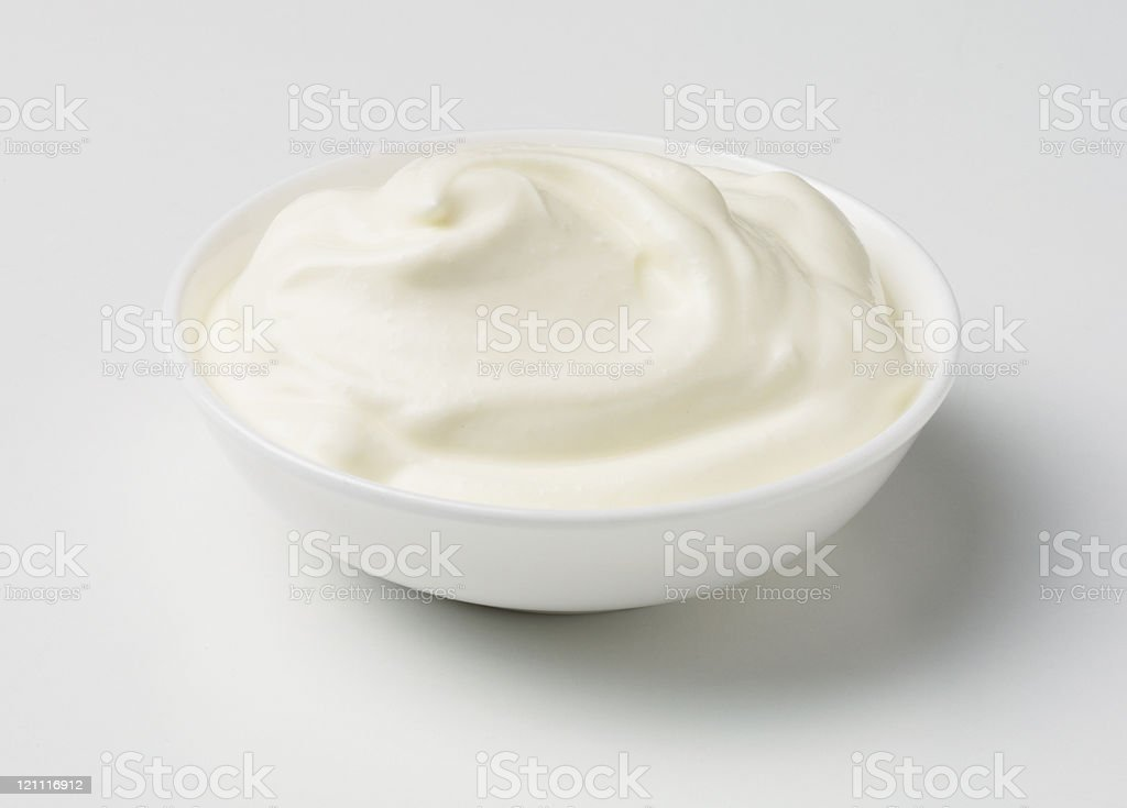 creme fraiche in a white bowl stock photo