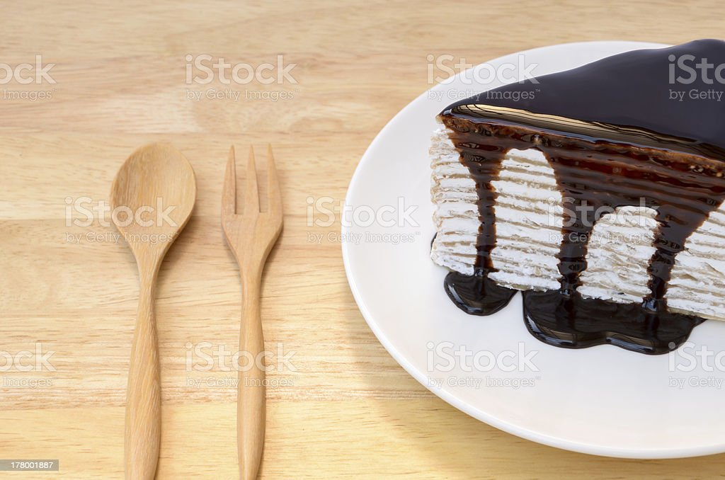 Crepe cake with chocolate sauce. royalty-free stock photo
