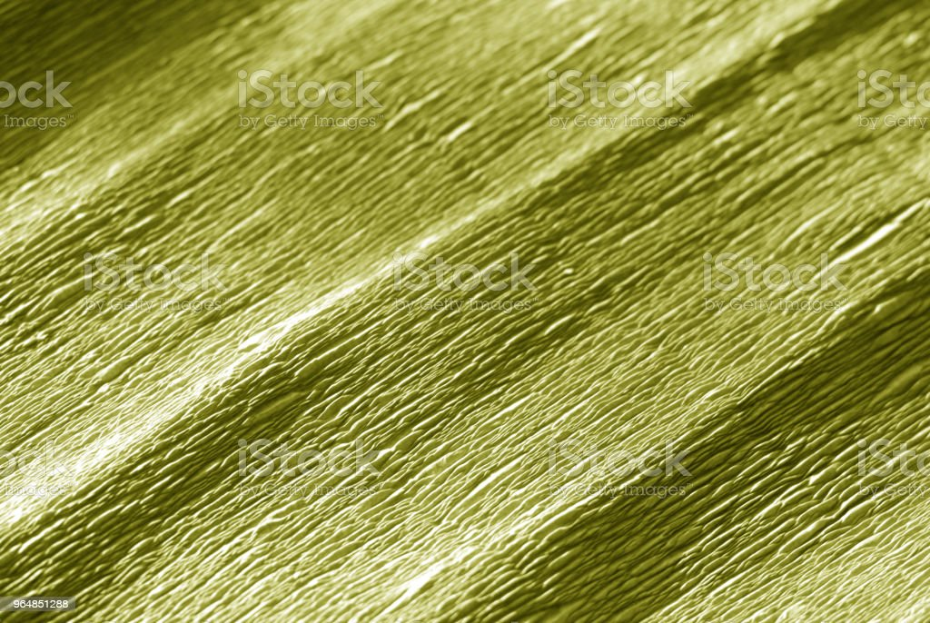 Crepe paper with blur effect in yellow color. royalty-free stock photo
