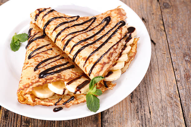 crepe with chocolate and banana - crepe bildbanksfoton och bilder