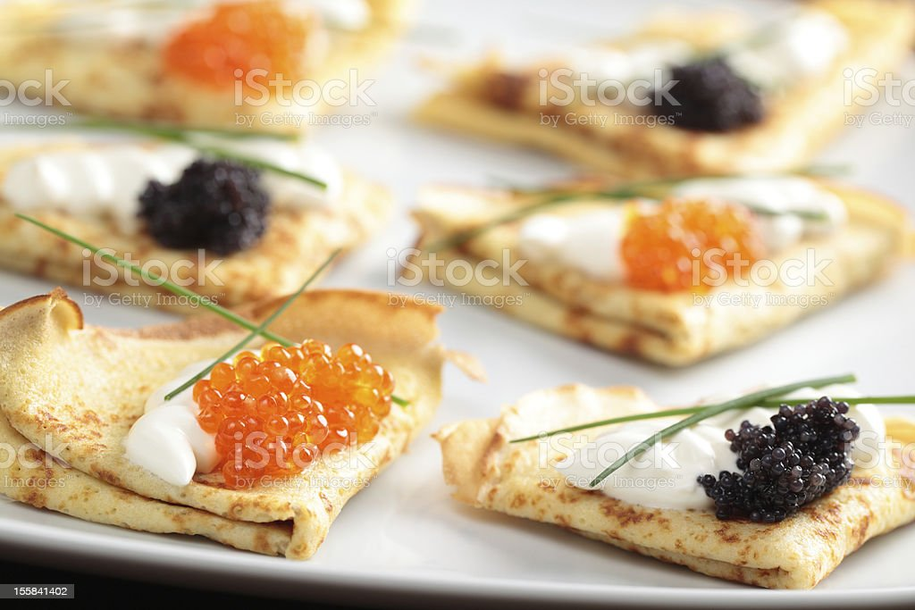 Crepes with caviar royalty-free stock photo