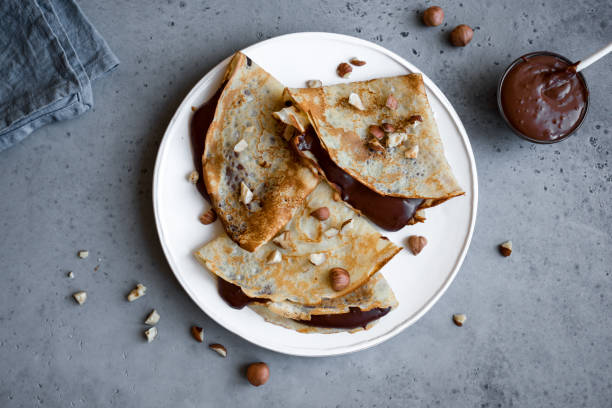 Crepes with chocolate spread Crepes with chocolate spread and hazelnuts. Homemade thin crepes for breakfast or dessert. pastry dough stock pictures, royalty-free photos & images