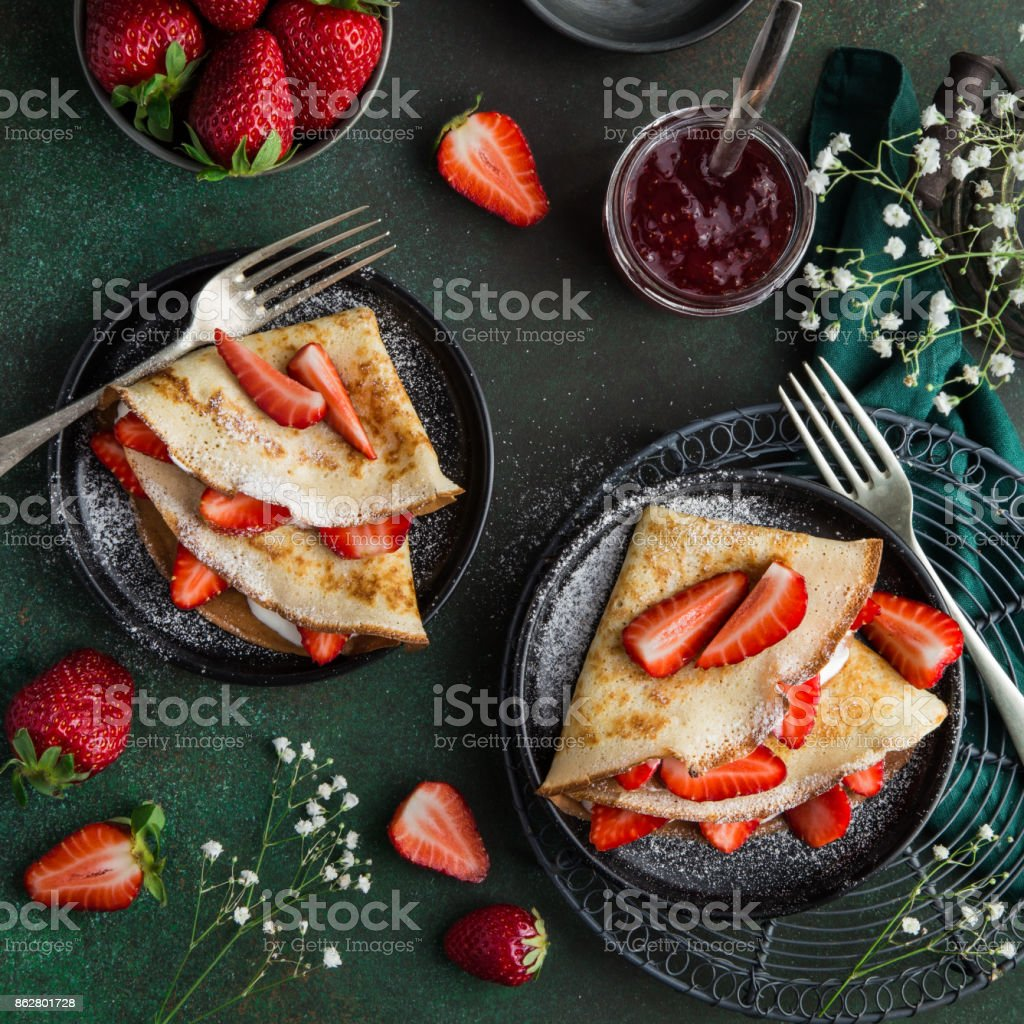 crepes with cream cheese and fresh strawberry stock photo
