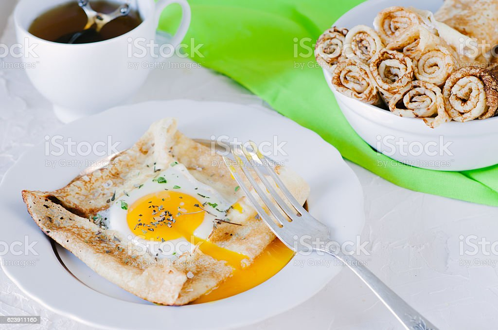 Crepes with egg, dried herbs and sea salt stock photo