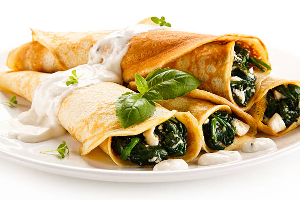 crepes with spinach and cream - savory food stock photos and pictures