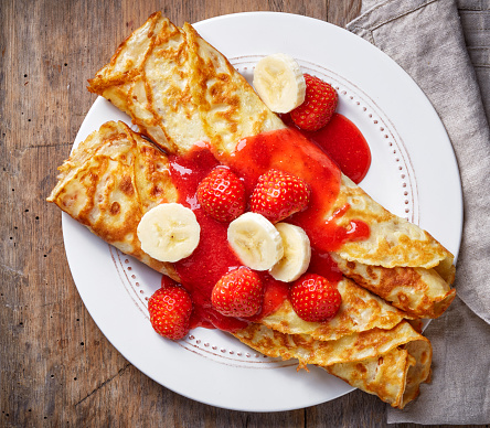 Crepes with strawberries and banana