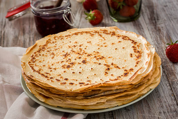 crepes with strawberry jam - crepe bildbanksfoton och bilder