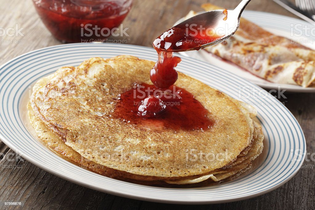 Crepes with strawberry jam royalty-free stock photo
