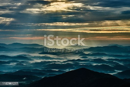 istock Crepuscular rays over the mountain range in the northern area of Hiroshima 1152961277
