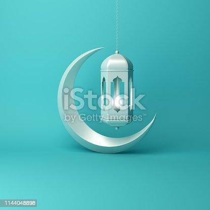 istock Crescent moon and arabic hanging lamp on blue pastel background studio lighting. 1144048898