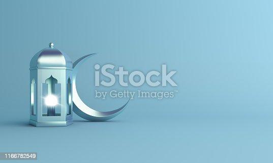 istock Crescent moon and arabic lantern on blue pastel background studio lighting. 1166782549