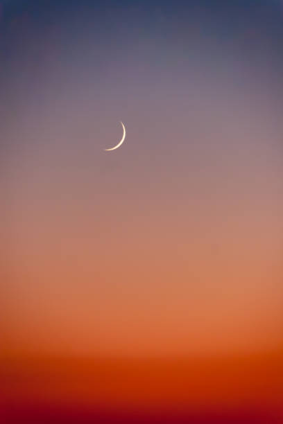 Crescent moon at sunset over the sea in Cyprus stock photo