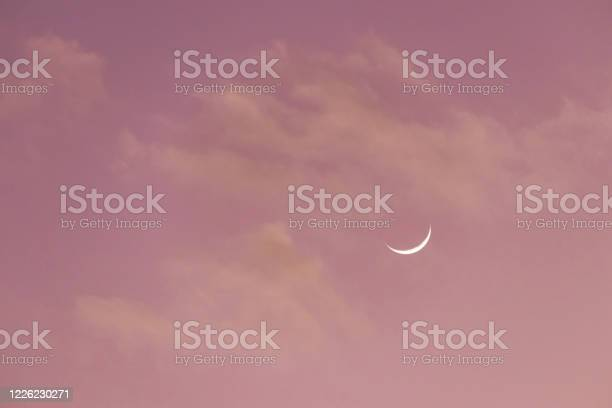 Photo of Crescent moon on sweet sky. Look like a smile on a good day.
