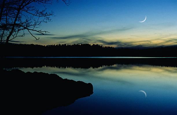 Crescent Moon on twilight sky stock photo