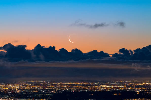 Crescent Moon Rising over Los Angeles at Dawn stock photo