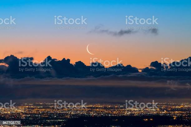 Photo of Crescent Moon Rising over Los Angeles at Dawn