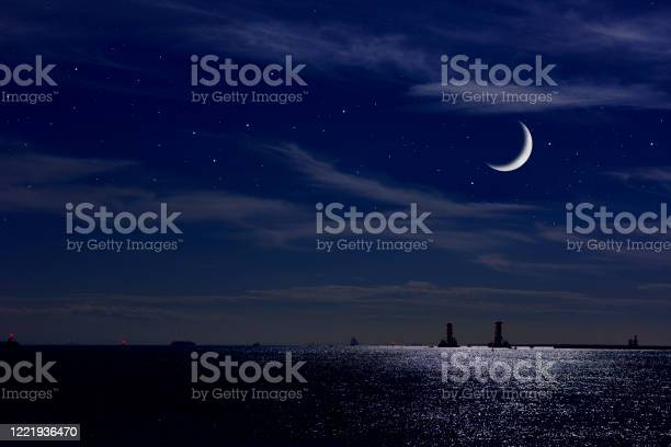 Photo of Crescent moon rising over the Tokyo bay area.