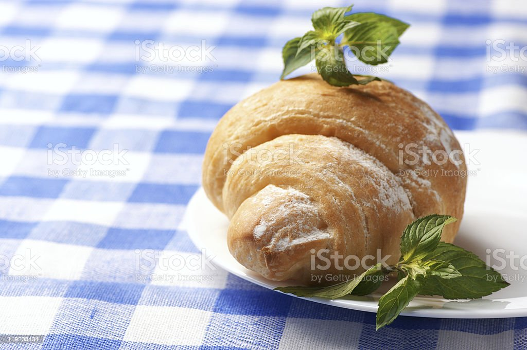 Croissant on plate royalty-free stock photo