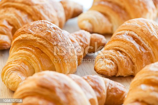 fresh croissants on the board
