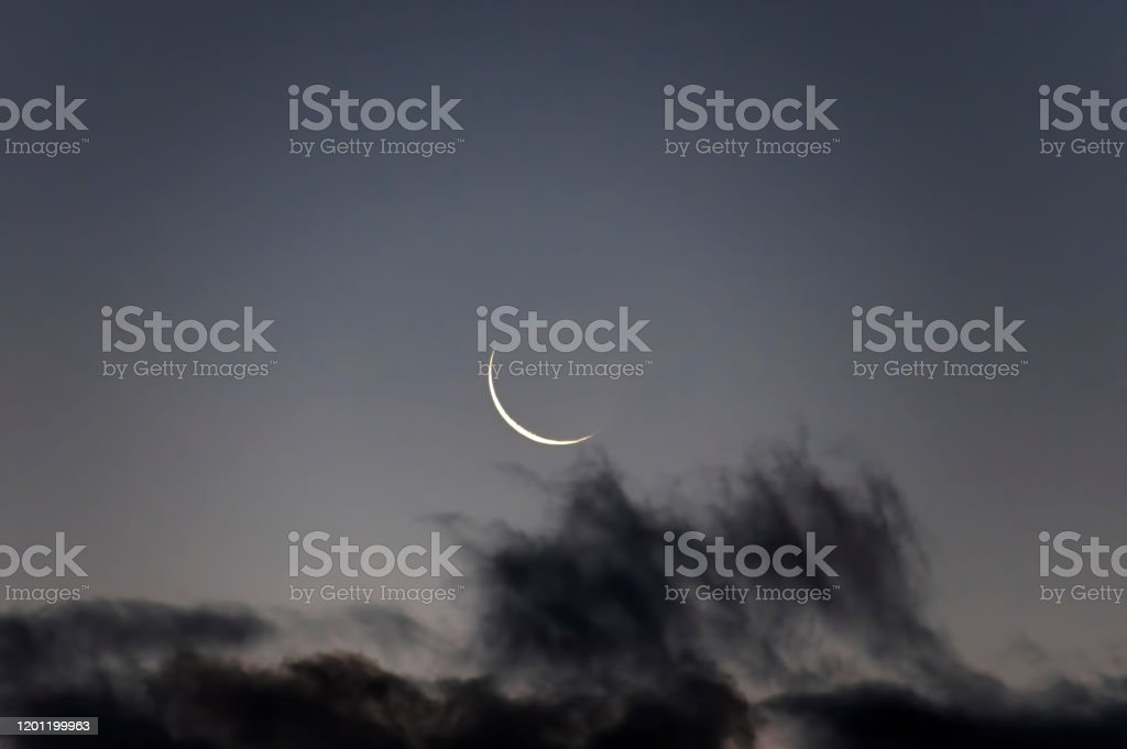 Crescent New moon during sunrise Astronomy Stock Photo