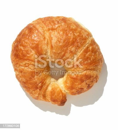Directly above a plain croissant on white background.