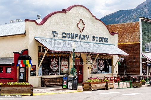 Crested Butte, USA - June 21, 2019: Colorado village stores shopping downtown in summer on elk avenue with vintage mountain architecture for secret stash pizza shop