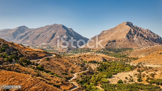Crete Island Mountain Range Panorama under clear blue Skyscape in warm late afternoon light. Central Crete Mountain Range, Crete Island, Kriti, Greece, Mediterranean Countries, Europe