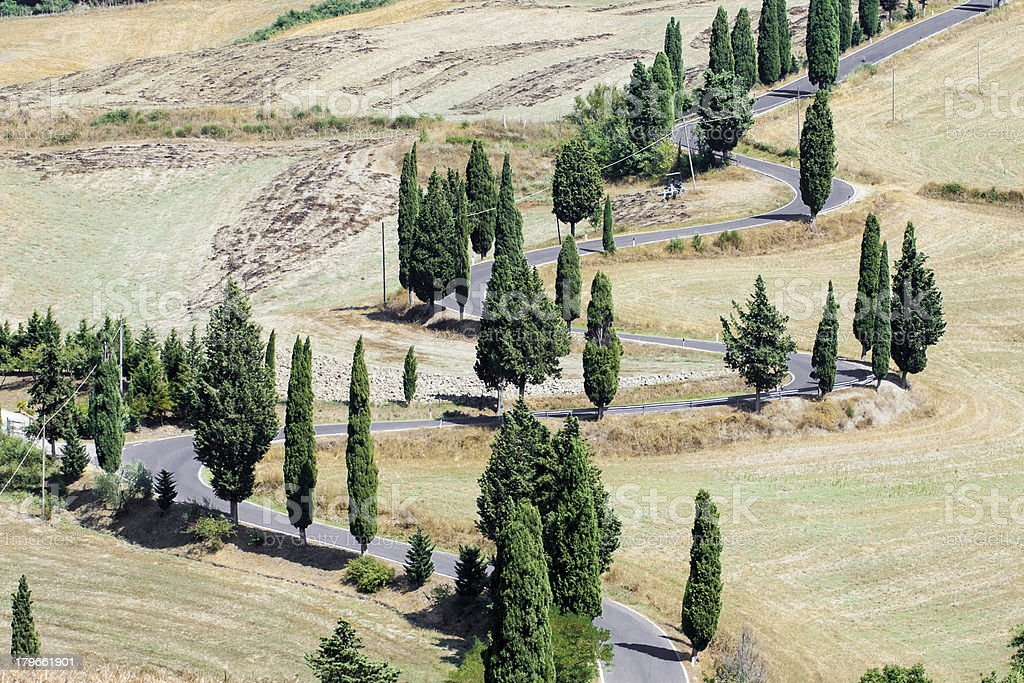 Crete senesi (Tuscany): Val d'Orcia landscape with road stock photo