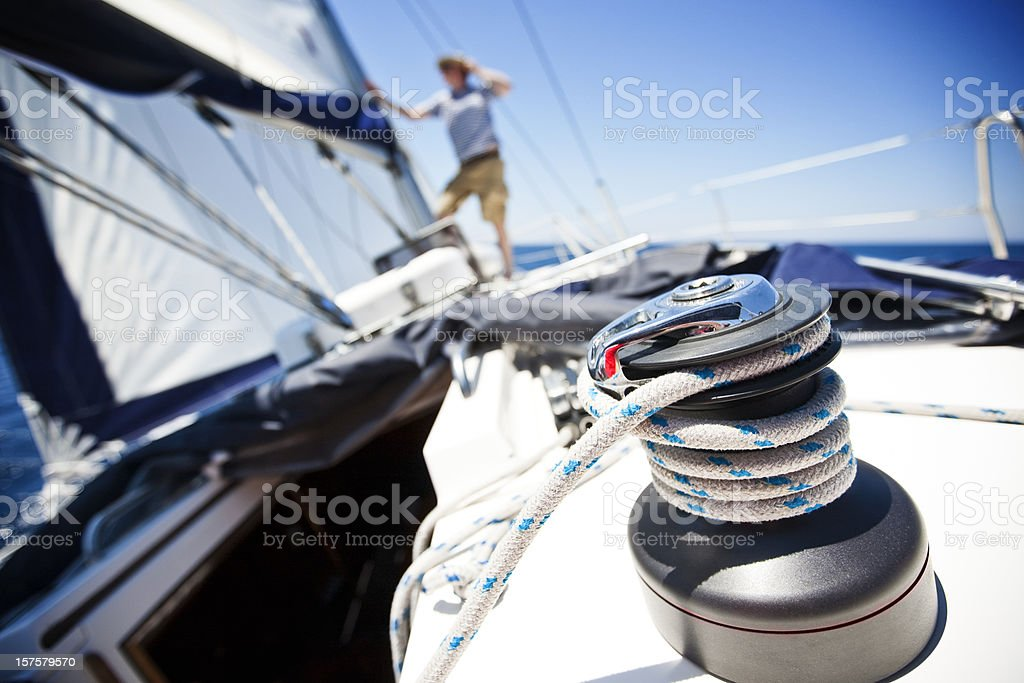 Crew member checking foresail royalty-free stock photo
