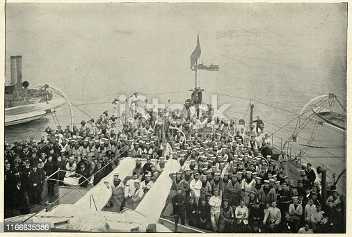 Vintage photograph of Crew of Royal Navy Warship HMS Magnificent (1894), one of the nine Majestic-class pre-dreadnought battleships of the Royal Navy.