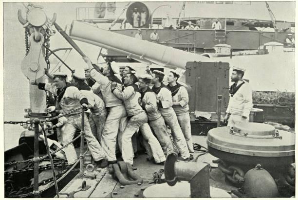 Crews pulling up anchor on HMS Majestic, Battleship stock photo