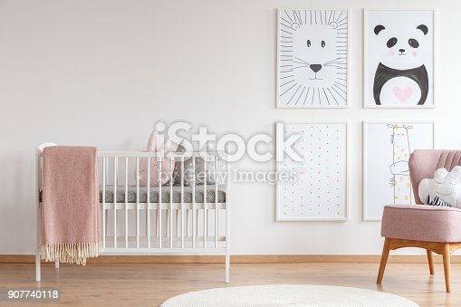 istock Crib in baby room 907740118