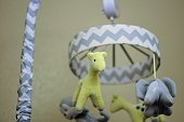 neutral grey and yellow baby mobile