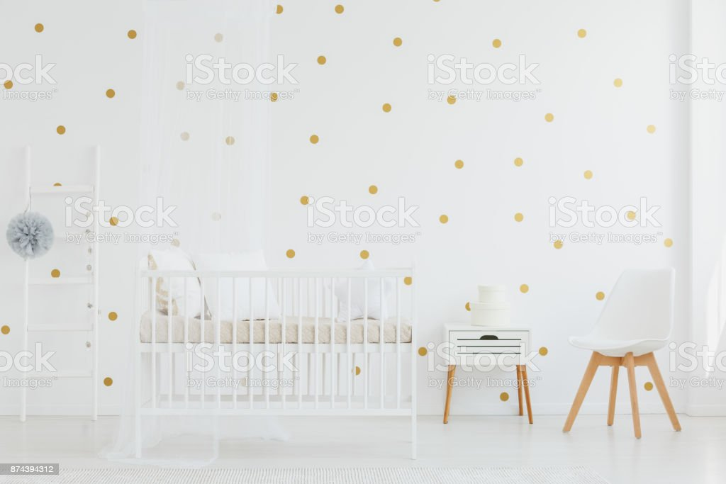 Crib next to cupboard stock photo