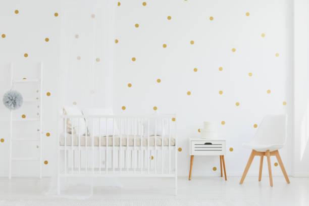 Crib next to cupboard stock photo