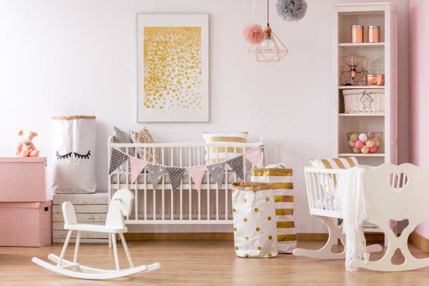 Crib nook with golden dots poster stock photo