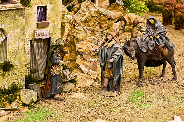 Crib scene Joseph, looking for cover for Virgin Mary, pregnant of Jesus Christ. inn stock pictures, royalty-free photos & images