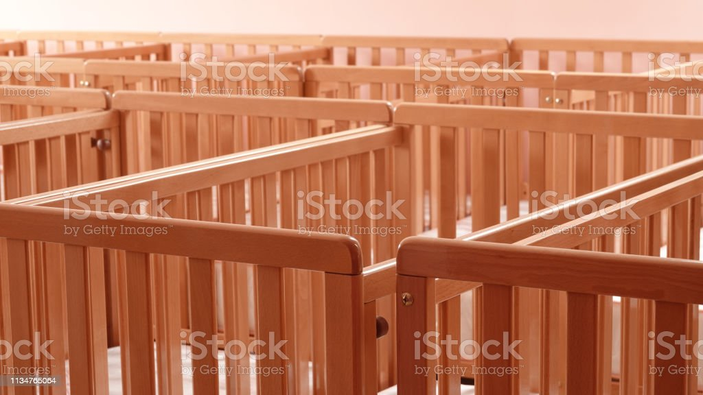 Here are cribs infant beds in maternity hospital or kindergarten day...