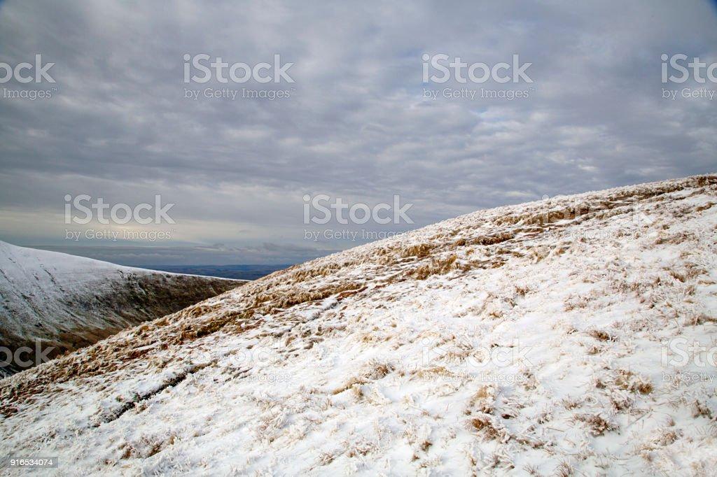 Cribyn mountain near Pen y Fan with Winter Snow stock photo