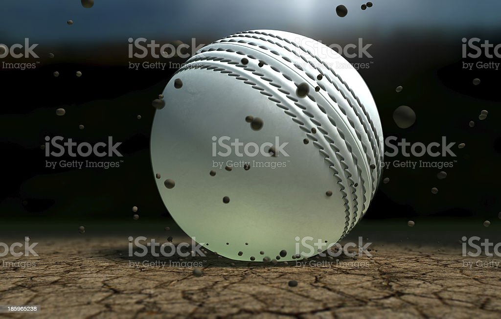 Cricket Ball Striking Ground With Particles At Night stock photo