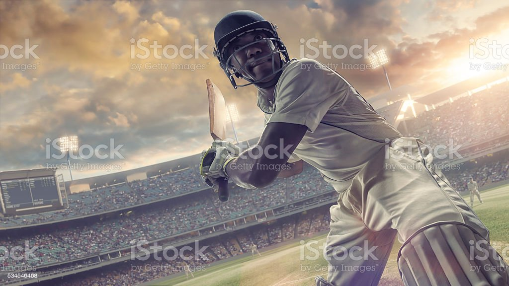 Cricket Batsman About to Hit Ball During Outdoor Cricket Match stock photo