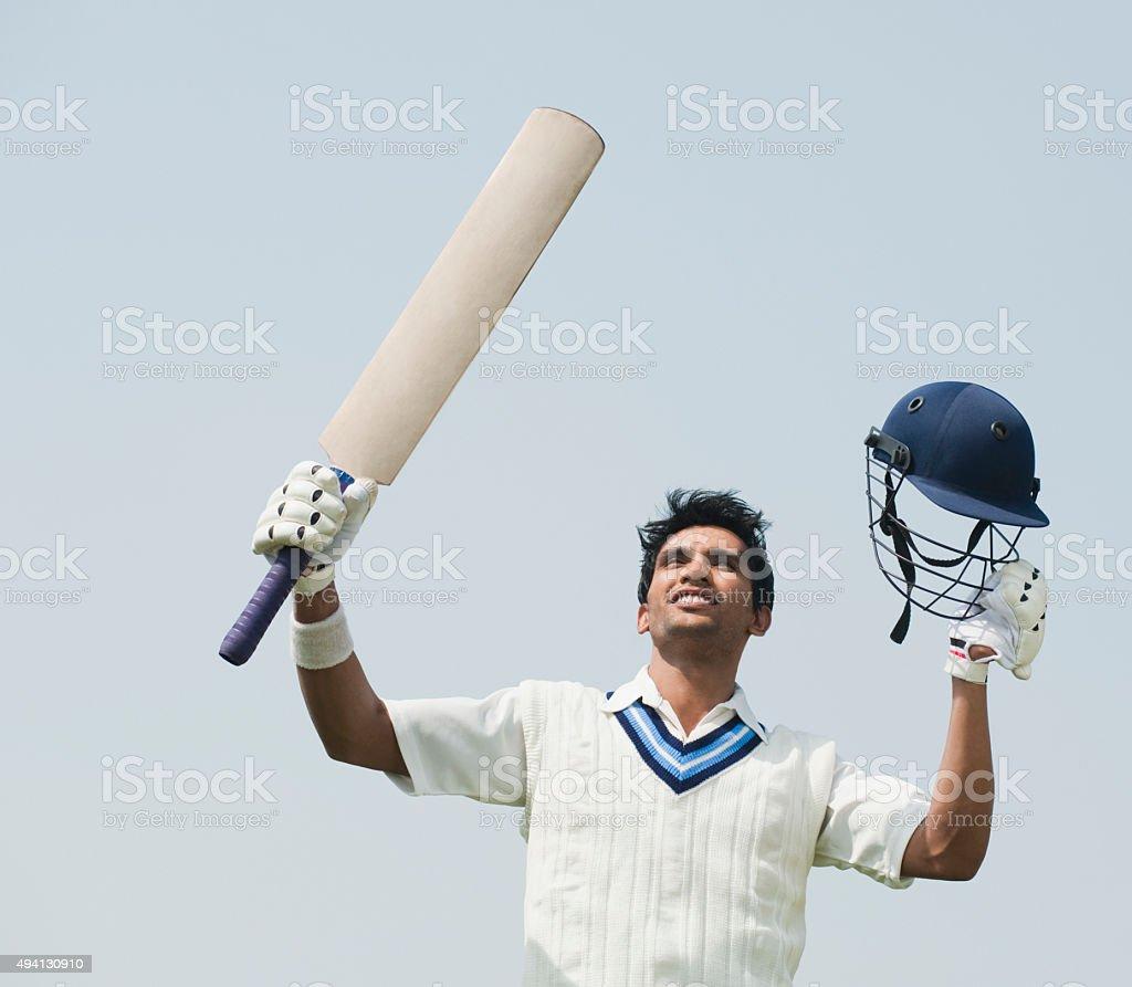 Cricket batsman celebrating his success stock photo