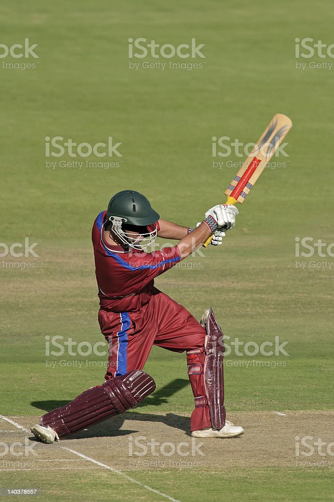 A cricket batsman in action royalty-free stock photo