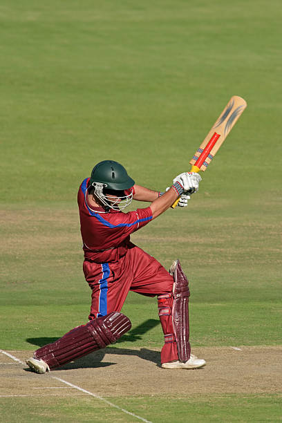 A cricket batsman in action stock photo