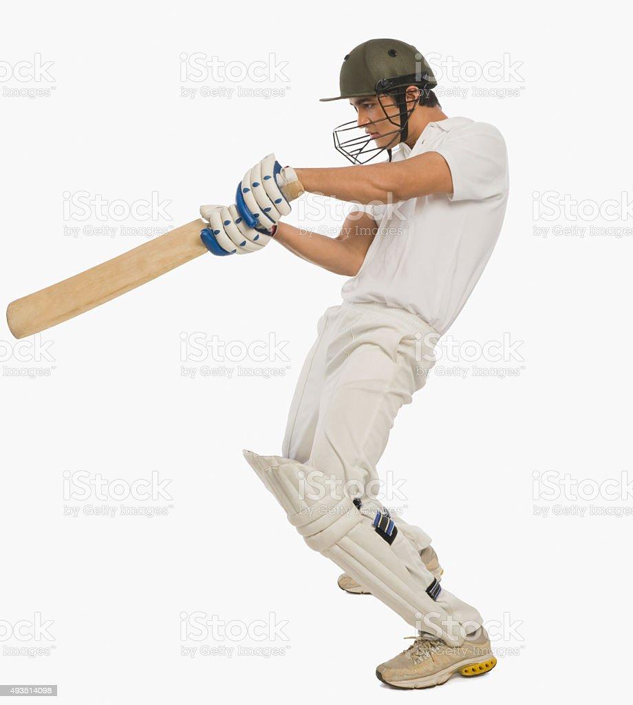 Cricket batsman playing a square cut shot stock photo