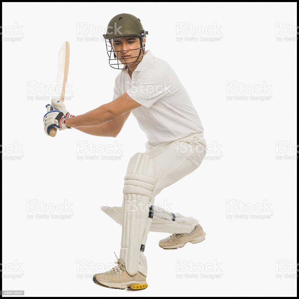 Cricket batsman playing a stroke stock photo