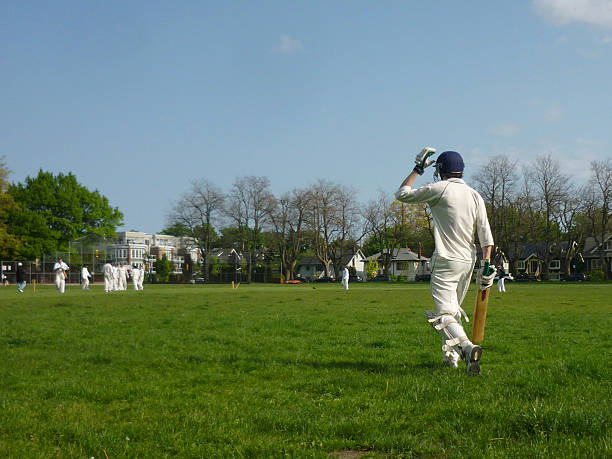 Batteur de Cricket, vue de derrière de partir à la batte - Photo