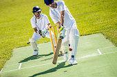 istock Cricket batter hitting the ball 1191513027