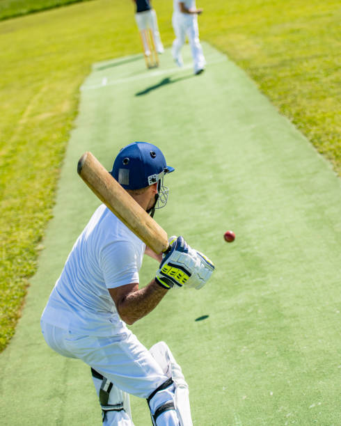 Cricket batter preparing to hit the ball